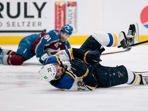 St. Louis Blues defenceman Justin Faulk (72) falls to the ice after being hit by Colorado Avalanche centre Nazem Kadri in the first round of the 2021 Stanley Cup playoffs at Ball Arena.
