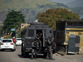 Rio's Civil Police officers are seen during a police operation agains drug traffickers at the Jacarezinho favela in Rio de Janeiro state, Brazil, on May 6, 2021.