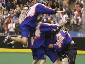 Members of the Toronto Rock celebrate after winning the 2011 NLL title at the then Air Canada Centre.