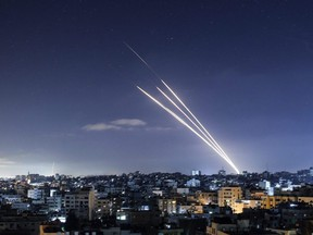 """Rockets are launched towards Israel from Gaza City, controlled by the Palestinian Hamas movement, on  Tuesday, May 18, 2021. Heavy air strikes and rocket fire in the Israel-Gaza conflict claimed more lives on both sides as tensions flared in Palestinian """"day of anger"""" protests in Jerusalem and the West Bank."""