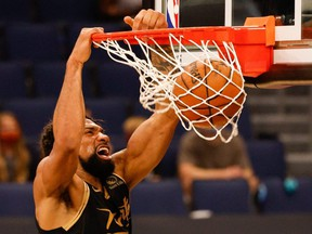 Khem Birch of the Toronto Raptors  dunks during a game against the Brooklyn Nets on April 27, 2021.