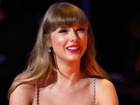 In a handout picture released by the Brit Awards, U.S. singer-songwriter Taylor Swift attends the Brit Awards 2021 in London on May 11, 2021.