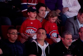 Justin Trudeau and his sons cheering on the Montreal Canadiens in the playoffs in 2014.