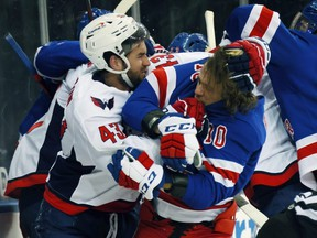 Capitlas winger Tom Wilson and Rangers star Artemi Panarin tussle during their infamous brawl on Monday. GETTY IMAGES