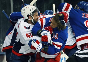 Tom Wilson of the Washington Capitals takes a roughing penalty against Artemi Panarin of the New York Rangers.