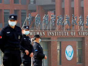 Security guards keep watch outside the Wuhan Institute of Virology during the visit by the World Health Organization team in Wuhan, China, Feb. 3, 2021.