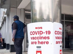 In this file photo signs offering Covid-19 vaccinations are seen outside of a CVS pharmacy in Washington, DC on May 7, 2021.