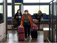 Passengers of TUI Airways flight from Dusseldorf arrive at Ioannis Kapodistrias International Airport, as the country's tourism season officially opens, on the island of Corfu, Greece, May 15, 2021.