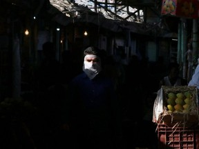 A man wearing a face mask walks in a fruit market amidst the spread of the coronavirus disease (COVID-19) in Mumbai, India, May 11, 2021.