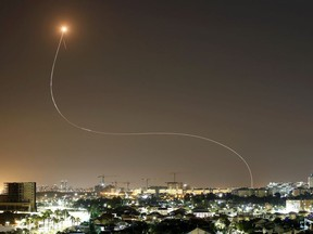 A streak of light is seen as Israel's Iron Dome anti-missile system intercepts rockets launched from the Gaza Strip towards Israel, as seen from Ashkelon, Israel May 11, 2021.