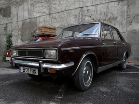 The Paykan Hillman-Hunter limousine, received by late Romania's communist dictator Nicolae Ceausescu in 1974 as a gift from Shad Mohammad Reza Pahlavi, is parked in the courtyard of Artmark auction house, in Bucharest, Romania, May 25, 2021.
