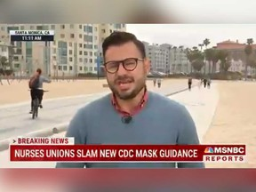 MSNBC reporter Guad Venegas is pictured reporting on live TV as a cyclist rides by moments before crashing while taking a selfie.
