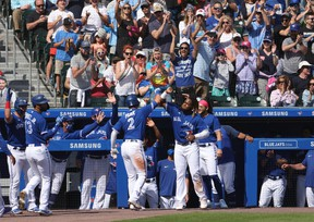 Blue Jays' Joe Panik  celebrates his three-run home run with teammates during the fourth inning against the Houston Astros at Sahlen Field.