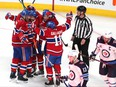 Montreal Canadiens left winger Artturi Lehkonen (62) celebrates his goal against Winnipeg Jets with teammates during the second period in Game 3 in Montreal last night.
