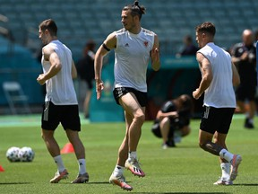 Wales forward Gareth Bale plays with a ball during their training session at Dalga Arena stadium in Baku on June 11, 2021. (Photo by OZAN KOSE / AFP) (Photo by OZAN KOSE/AFP via Getty Images)