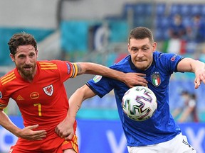 Italy's forward Andrea Belotti, right, battles for the ball with Wales midfielder Joe Allen during the UEFA Euro 2020 Group A football match between Italy and Wales at the Olympic Stadium in Rome on June 20, 2021.