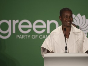 New Green party leader Annamie Paul smiles as she speaks at the party leadership announcement in Ottawa, Oct. 3, 2020.