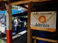 Bitcoin banners are seen outside a small restaurant at El Zonte Beach in Chiltiupan, El Salvador, Tuesday, June 8, 2021.