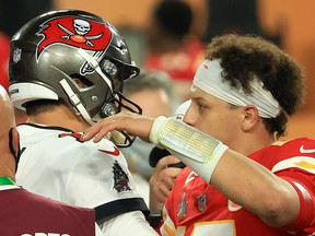 Tom Brady of the Tampa Bay Buccaneers and Patrick Mahomes of the Kansas City Chiefs speak after Super Bowl LV at Raymond James Stadium on February 7, 2021 in Tampa, Florida.    (Photo by Mike Ehrmann/Getty Images)