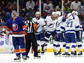 Lightning forward Brayden Point (21) is congratulated by his teammates after scoring a goal as Islanders defenceman Andy Greene (left) reacts during the second period in Game 3 of the Stanley Cup Semifinals at Nassau Coliseum in Uniondale, N.Y., Thursday, June 17, 2021.
