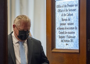 Ontario Premier Doug Ford leaves his office for a press conference at the Ontario Legislature in Toronto, Thursday, May 13, 2021.