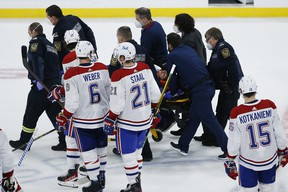 Montreal Canadiens' Jake Evans (71) is taken off the ice on a stretcher after getting hit by Winnipeg Jets' Mark Scheifele (55) during third period NHL Stanley Cup hockey action in Winnipeg, Wednesday, June 2, 2021.