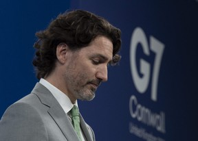 Canadian Prime Minister Justin Trudeau listens to  question during a news conference at Tregenna Castle following the G7 Summit in St. Ives, Cornwall, England, on Sunday, June 13, 2021.