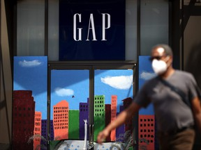 A pedestrian walks by the closed Gap flagship store on August 18, 2020 in San Francisco, Calif.