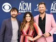 From left to right: Dave Haywood, Hillary Scott and Charles Kelley of country music group Lady A arrive for the 54th Academy of Country Music Awards on April 7, 2019, at the MGM Grand Garden Arena in Las Vegas, Nevada.