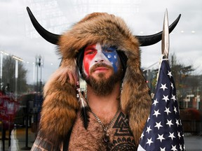 Jacob Anthony Chansley, also known as Jake Angeli, of Arizona, poses with his face painted in the colours of the U.S. flag as supporters of U.S. President Donald Trump gather in Washington, D.C., Jan. 6, 2021.