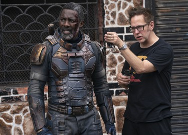 DRIS ELBA and writer/director JAMES GUNN on the set of THE SUICIDE SQUAD.