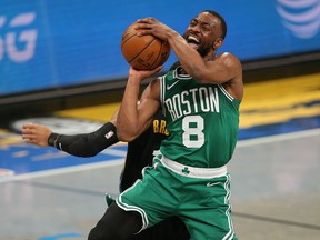 Boston Celtics point guard Kemba Walker (8) is fouled as he shoots at Barclays Center.