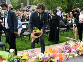 Prime Minister Justin Trudeau places flowers at a vigil outside the London Muslim Mosque organized after four members of a Canadian Muslim family were killed in what police describe as a hate-motivated attack in London, Ont., June 8, 2021.