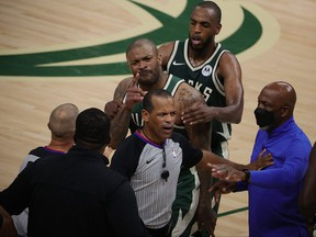 P.J. Tucker of the Milwaukee Bucks is held back by Khris Middleton during an altercation with Kevin Durant of the Brooklyn Nets in the second half of Game 3 of the Eastern Conference second round playoff series at the Fiserv Forum on June 10, 2021 in Milwaukee, Wis.