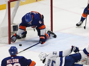 New York Islanders defenceman Ryan Pulock makes a last-second save along the goal line to secure a win against the Tampa Bay Lightning during the third period of Game 4 of their series on Saturday.