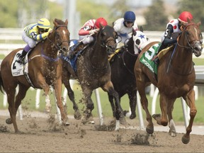 Jockey Patrick Husbands guides Live Oak Plantation's Souper Stonehenge (right) to victory over (yellow silks) #2 Pink Lloyd in the $150,000 Jacques Cartier Stakes on June 20, 2021.