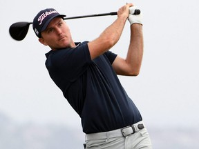 Russell Henley plays his shot from the fourth tee during the second round of the U.S. Open golf tournament at Torrey Pines Golf Course on June 18, 2021.