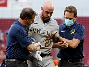 Travis Shaw of the Milwaukee Brewers leaves the game after being injured against the Cincinnati Reds at Great American Ball Park on June 9, 2021 in Cincinnati.
