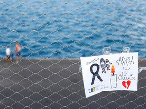 A sign placed on a fence in memory of the missing girls in the Canary Islands is seen in Santa Cruz de Tenerife, Spain June 11, 2021.