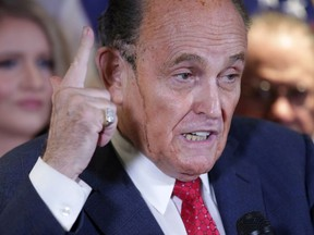 Sweat runs down the face of former New York City Mayor Rudy Giuliani, personal attorney to U.S. President Donald Trump, as he speaks about the 2020 U.S. presidential election results during a news conference at Republican National Committee headquarters in Washington, U.S., November 19, 2020.