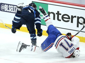 Winnipeg Jets centre Mark Scheifele (left) level Montreal Canadiens centre Jake Evans after his empty-net goal during Game 1 of the North Division final in Winnipeg on Wed., June 2, 2021. KEVIN KING/Winnipeg Sun/Postmedia Network