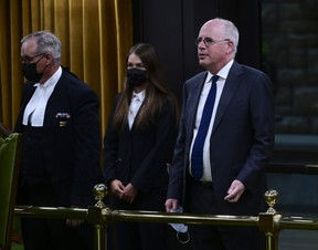 President of the Public Health Agency of Canada  Iain Stewart, right, approaches the bar in the House of Commons to be admonished by the Speaker of the House of Commons Anthony Rota on Parliament Hill in Ottawa on Monday, June 21, 2021.