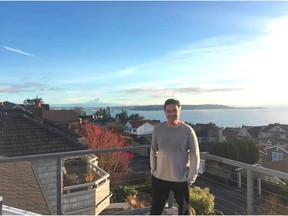 """""""In general it's a laid-back atmosphere out here,"""" says Seattle Times writer Geoff Baker, shown here on the balcony of his home. """"There's some great natural sites to see. You can buy property out here where you'll see mountains, you'll see water."""""""