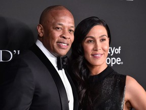 Dr. Dre (L) and Nicole Young attend the City of Hope Spirit of Life Gala 2018 at Barker Hangar on October 11, 2018 in Santa Monica, California.