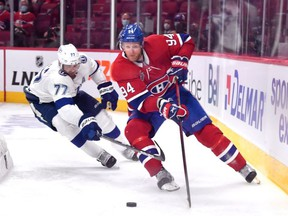 Victor Hedman #77 of the Tampa Bay Lightning defends Corey Perry #94 of the Montreal Canadiens during the third period in Game Three of the 2021 NHL Stanley Cup Final at Bell Centre on July 02, 2021 in Montreal, Quebec, Canada.