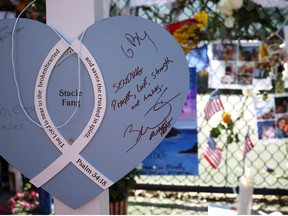 A note left by former NBA player Dwyane Wade of the Miami Heat is seen at the memorial site for victims of the collapsed 12-story Champlain Towers South condo building on July 08, 2021 in Surfside, Florida.