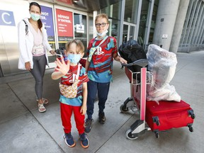 Katharina Cole and her two sons, Leo, 12 and Max, 6, are pictured at Pearson International Airport on July 5, 2021.