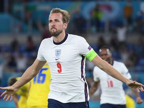 England striker Harry Kane celebrates scoring the team's third goal during the UEFA EURO 2020 quarter-final football match between Ukraine and England at the Olympic Stadium in Rome on July 3, 2021.