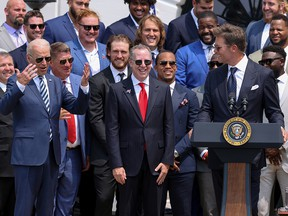 U.S. President Joe Biden reacts to a quip from Tampa Bay Buccaneers quarterback Tom Brady during a reception for the team at the White House in Washington July 20, 2021.