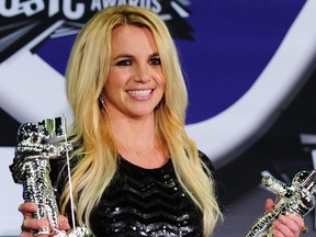In this file photo, Britney Spears holds her Best Pop Video Award and her Michael Jackson Video Vanguard Award in the press room at the 2011 MTV Video Music Awards at the Nokia Theater in downtown Los Angeles, Aug. 28, 2011.